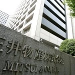 A woman walks past the headquarters of Japanese general trading company Mitsui & Co., Ltd. in Tokyo July 9, 2009.